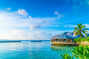 Beautiful water villas in tropical Maldives island at the sunris