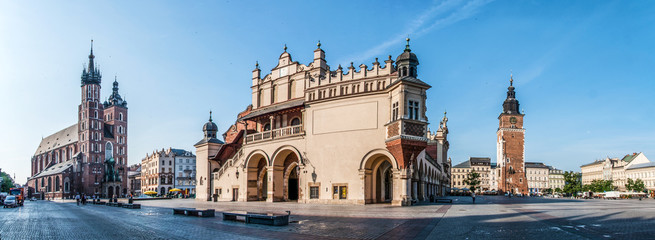 Panorama of Main Market Square (Rynek) in Cracow, Poland with the Renaissance Drapers' Hall (Sukiennice), Gothic St Mary church, medieval city hall tower. The biggest medieval market square in Europe