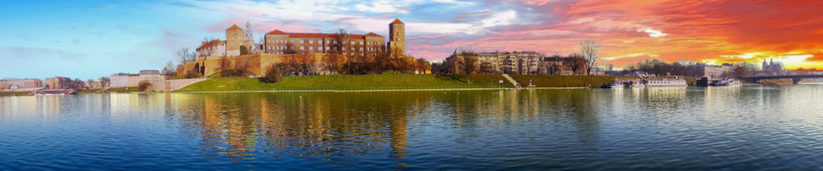 Famous landmark Wawel castle seen from Vistula at sunrise, Krakow, Poland.