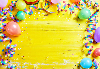 Bright colorful carnival or party frame on yellow