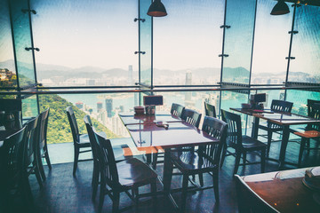 Restaurant with views of the big city with skyscrapers. Hong Kon