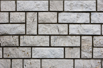 White bricks in layers as a cladding of a wall