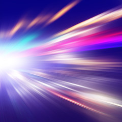 Traffic lights in motion blur at night.
