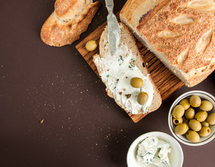 Homemade bread with cream cheese and olives