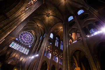 PARIS - OCTOBER1, 2016: Notre Dame de Paris Cathedral Interior on October 1, 2016. Notre Dame construction began in the year 1163 and was completed in the year 1345.