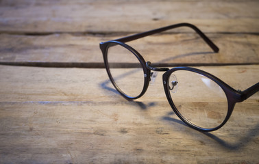 eyeglasses on wood table