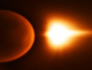 Orange space planet with light leak bokeh background