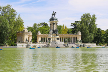 Beautiful of tourists on boats at Monument to Alfonso XII in the Parque del Buen Retiro, Park del Retiro, Madrid, Spain