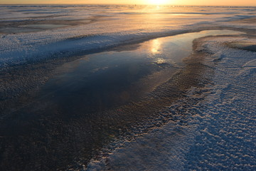 Ice desert at sunset winter sun natural beauty