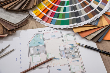 architectural drawings with palette of colors and wooden sampler for furniture designs for interior works.