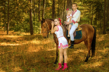 Ukrainians Mom and Dad and daughter in the woods