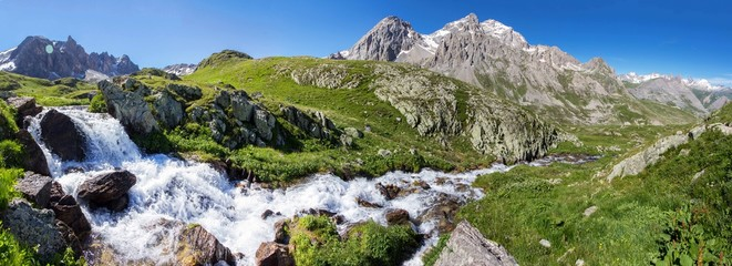 Waterfall in muntains europe Alps