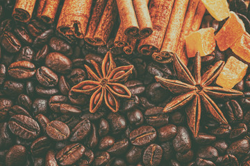 Coffee cup, spices and chocolate on wooden table texture with co