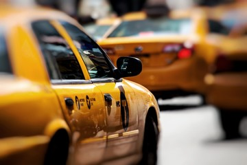 Yellow cab speeds through Times Square in New York, NY, USA.
