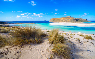 Amazing panorama of Balos Lagoon with magical turquoise waters, lagoons, tropical beaches of pure white sand and Gramvousa island on Crete, Greece
