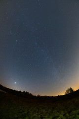 Astro landscape with the Milky Way and the bright Venus as seen from the Palatinate Forest in Germany.