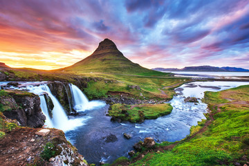 The picturesque sunset over landscapes and waterfalls. Kirkjufel