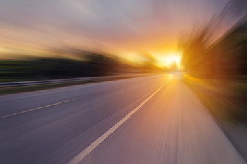 Abstract motion blur of the road and sunset