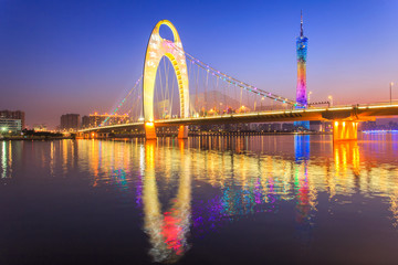 River with modern city landmark architecture backgrounds of pink clouds in Guangzhou China ,Zhujiang River and modern building of financial district in guangzhou china