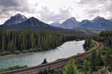 river, railway and Rocky Mountains in Banff National Park, Alberta