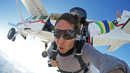 Self portrait skydiving tandem jump from the plane