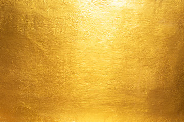 Gold concrete wall on background texture.