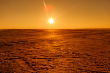 Martian sunset (Mars planet) red landscape. Looks like cold desert on Mars. A huge field of ice