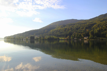 Travel to Attersee, Austria. The view on the lake with the mountains on the background in the sunny day.