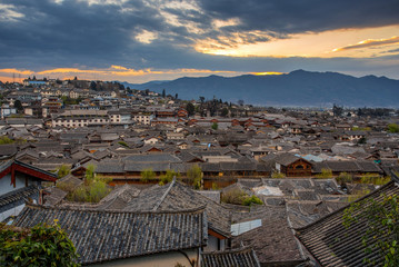 Lijiang Old Town bird eye top top view with local historical architectures roof building in sunrise scene