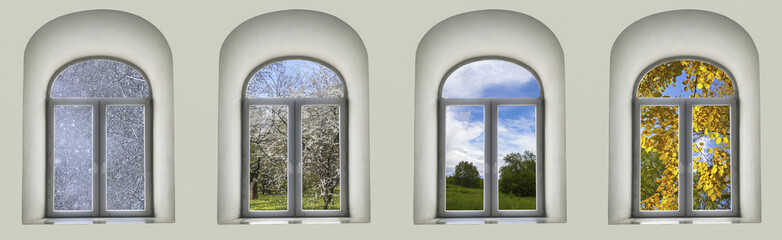 white semicircular modernist windows on a black wall.Four seasons - winter, spring, summer, autumn in the window