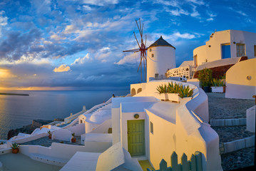 Windmill in the village of Oia at sunset, Santorini, Greece