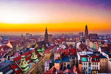 Panorama illuminated old town of Wroclaw at night. Popular travel destination in Poland. High dynamic range.