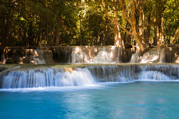 Deep blue stream waterfall, in national forest park of Thailand