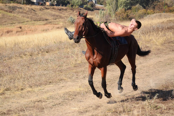 The guy is riding a horse