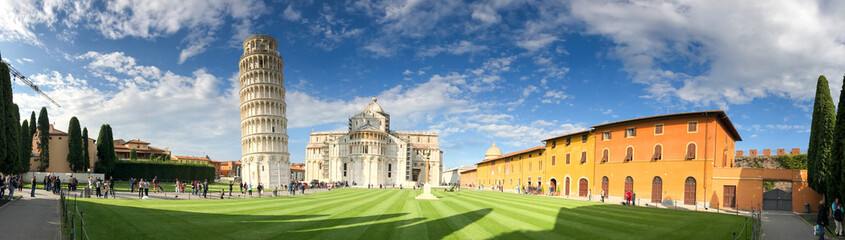 PISA - OCTOBER 10, 2016: Tourists in Square of Miracles. Pisa attracts 3 million people annually