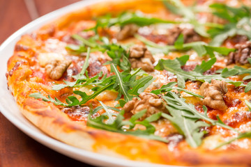 Tasty arugula nuts and blue cheese pizza