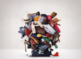Big heap of different clothes and shoes