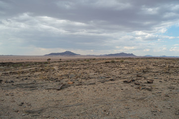 Stony Desert with Mountains between Walvis Bay and Solitaire in Namibia