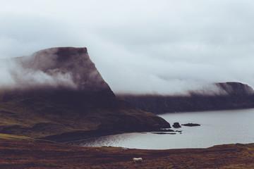Misty cloud on coast of Isle of Skye Scotland