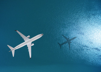 Airplane flies over a sea, view from above