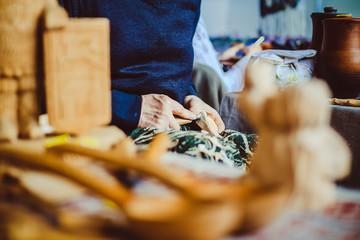 a craftsman carves wood