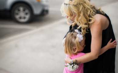 Mother and daughter hugging outside in downtown Pleasant Grove
