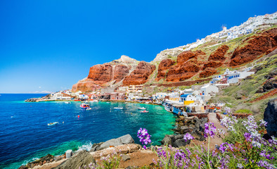 The old harbor of Ammoudi under the famous village of Ia at Santorini, Greece.