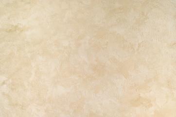Teksturowane tło. Dekoracyjne ściany gipsowe, zewnętrzna dekoracja elewacji. Tekstura beżu.