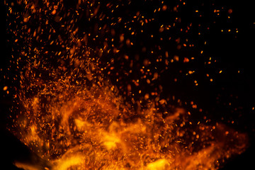 fire flames with sparks on a black background