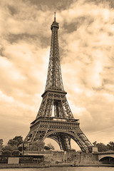 While French elections are making headlines, Eiffel Tower remains popular as ever with tourists, Paris France. Sepia filter
