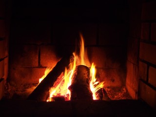 Fire in fireplace at night