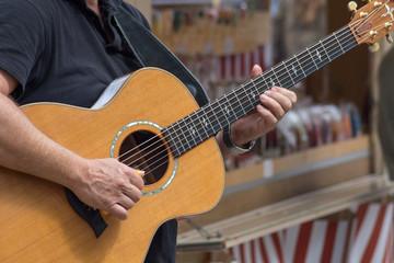 guitar player in street