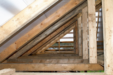 Building Attic Interior. Wooden Roof Frame House Construction. Roofing Construction Indoor.