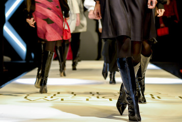 models are walking - female legs on a fashion show